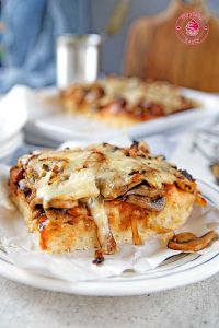 homemade pizza with mushrooms and onion